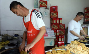 brothers making mooncakes at shop in xi'an