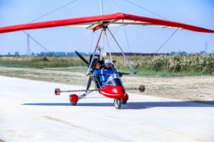 front view of pilot in home-made light aircraft on runway