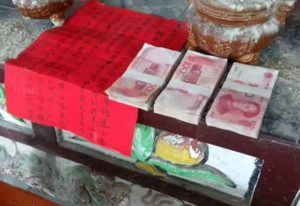 pile of money and note on a table