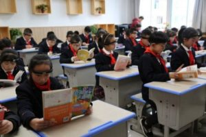 children wearing headbands in class at school in china