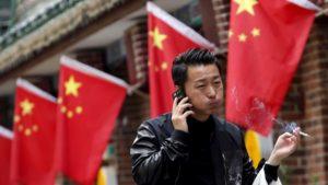 man smoking on street in china