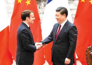 xi and macron shaking hands