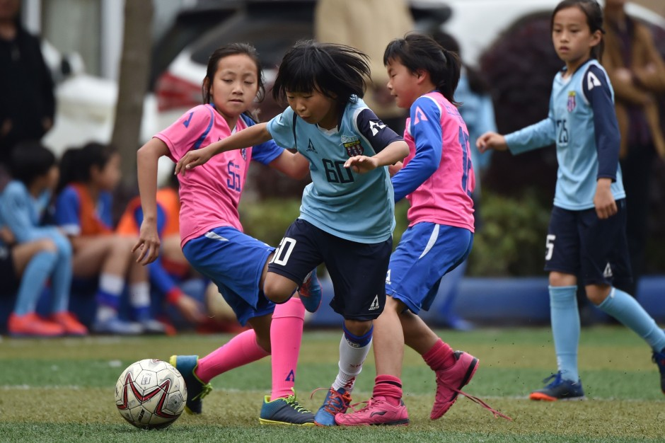 girls playing football in china