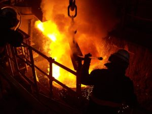 workers working at furnace