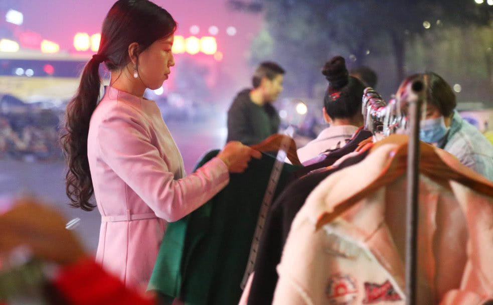 woman selling clothes on street in china