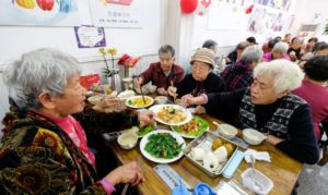 elderly people eating lunch