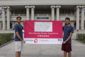 students holding sign promoting their trip