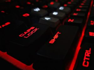 black keyboard lit up with red