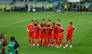 Chinese Invention: Chinese football team on pitch
