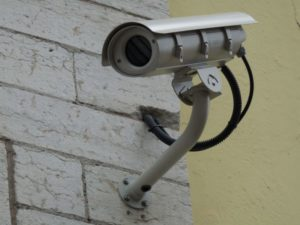 surveillance camera fitted to wall