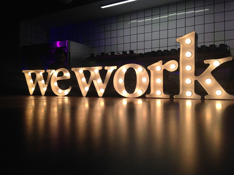 wework logo lit up with lights