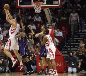 NBA players shooting a hoop