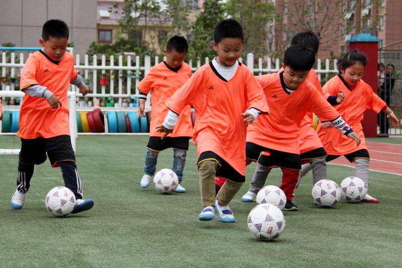 kindergarten children playing football