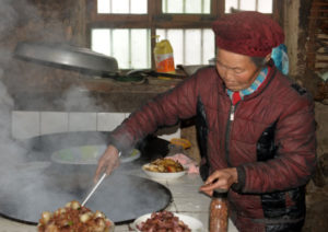 elderly woman cooking at home