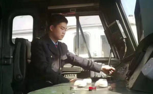 side view of man in train drivers seat