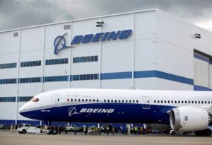 side view of boeing plane outside company building