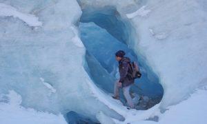 man hiking in glacier