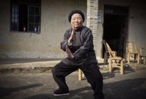 elderly woman practicing martial arts