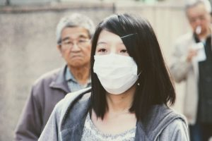 woman wearing surgical mask outside