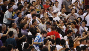 Kobe Bryant surrounded by Chinese fans