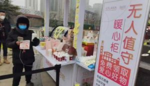 desk outside beijing shopping mall offering presents to couriers