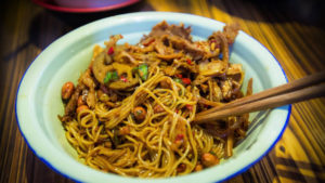 chinese noodle dish with chopsticks
