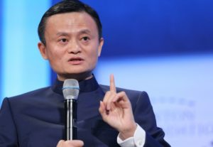 front view of jack ma holding microphone while giving talk
