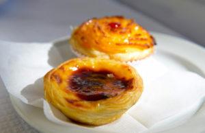 two custard tarts on a plate