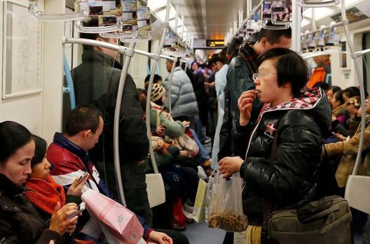 passenger eating on metro in china