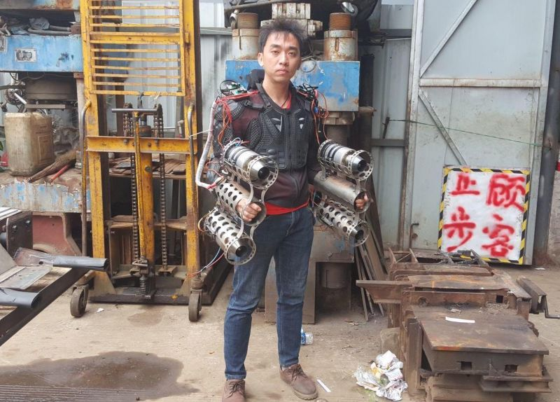 man wearing home-made flying suit in china
