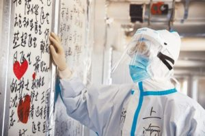 china medical worker reading wall messages