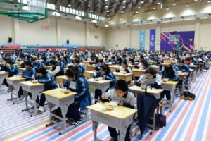 students eating lunch in school gymnasium in china