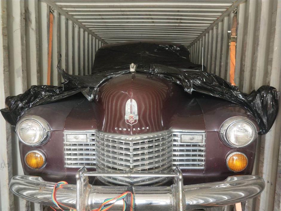 front view of old cadillac in shipping container