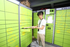 man putting parcel in locker in china