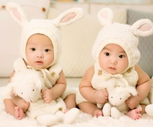 asian babies dressed as rabbits