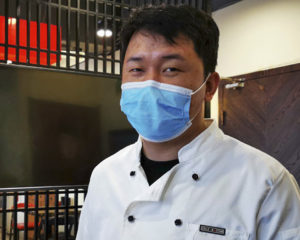 chef wearing face mask in china