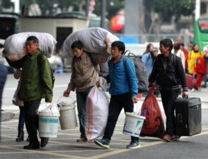 migrant workers crossing street in china