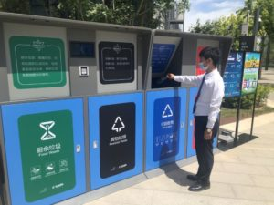 man using intelligent rubbish sorting bins in beijing