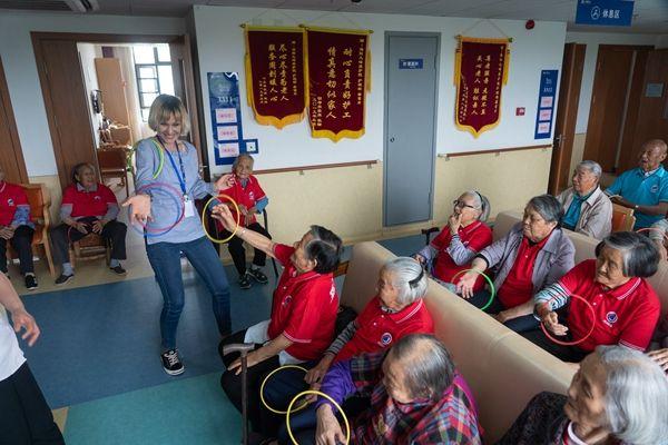 latvian nursing home director entertaining elderly in china
