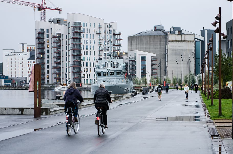 back view of two people cycling in london