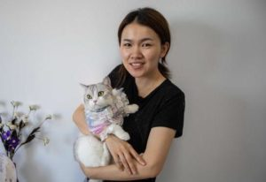 girl holding cat wearing han style chinese clothes