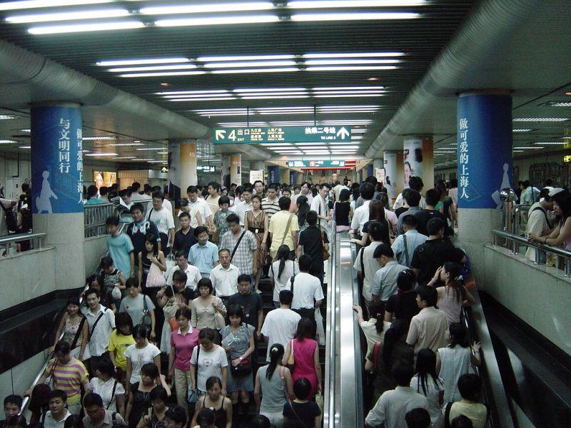 crowd of people using shanghai metro