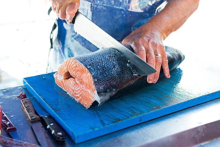 salmon being cut on board