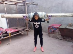girl working out in home-made gym in china