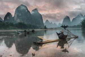 Chinese Cities: large lake with Chinese fishermen