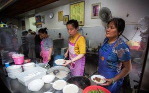 women serving breakfast at restaurant in china