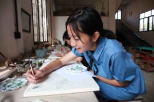 children drawing at rural art school in china
