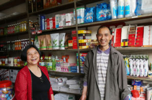 couple posing for picture in shop in china