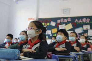 school children wearing masks during class in china