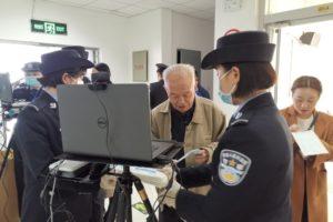 elderly man taking exam at police station in china